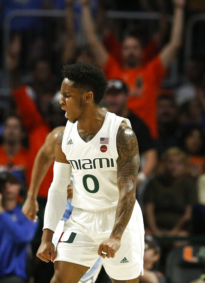Miami guard Chris Lykes reacts after scoring against North Carolina during the first half of an NCAA college basketball game on Saturday, Jan. 19, 2019, in Coral Gables, Fla. (AP Photo/Brynn Anderson)