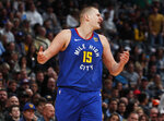 Denver Nuggets center Nikola Jokic reacts after being called for a technical foul while arguing with a referee for a call against the Philadelphia 76ers in the first half of an NBA basketball game Friday, Nov. 8, 2019, in Denver. (AP Photo/David Zalubowski)