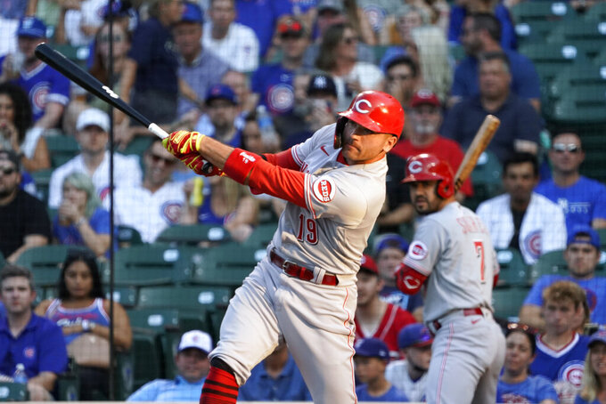Cincinnati Reds' Joey Votto hits a home run against the Chicago Cubs during the first inning of a baseball game, Tuesday, July 27, 2021, in Chicago. (AP Photo/David Banks)