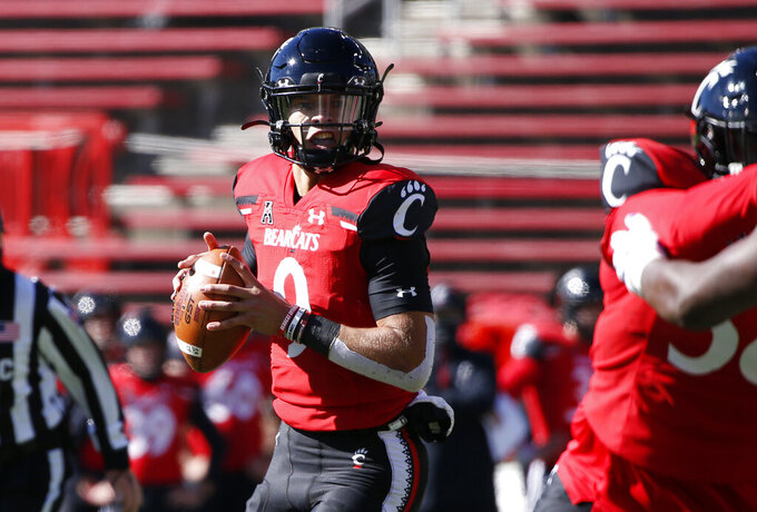 Cincinnati quarterback Desmond Ridder (9) looks to throw against Memphis during the first half of an NCAA college football game Saturday, Oct. 31, 2020, in Cincinnati. (Photo by Gary Landers)