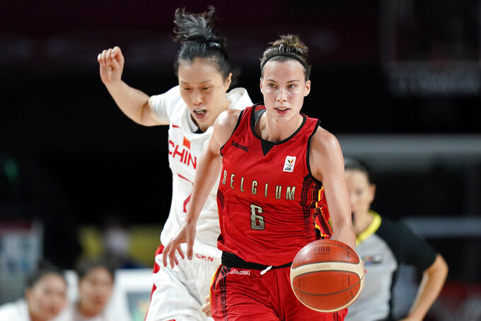 Belgium's Antonia Delaere (6) drives up court ahead of China's Ting Shao (7) during a women's basketball preliminary round game at the 2020 Summer Olympics, Monday, Aug. 2, 2021, in Saitama, Japan. (AP Photo/Charlie Neibergall)