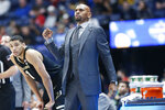 Vanderbilt head coach Jerry Stackhouse watches the action in the first half of an NCAA college basketball game against Arkansas in the Southeastern Conference Tournament Wednesday, March 11, 2020, in Nashville, Tenn. (AP Photo/Mark Humphrey)