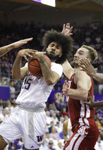 Washington's Marcus Tsohonis (15) tries to hold on to the ball in front of Washington State's Jeff Pollard during the first half of an NCAA college basketball game Friday, Feb. 28, 2020, in Seattle. (AP Photo/Elaine Thompson)