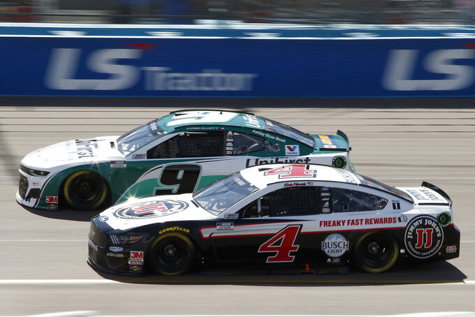 Kevin Harvick (4) races Chase Elliott (9) for the lead through Turn 4 during a NASCAR Cup Series auto race at Phoenix Raceway, Sunday, March 8, 2020, in Avondale, Ariz. (AP Photo/Ralph Freso)
