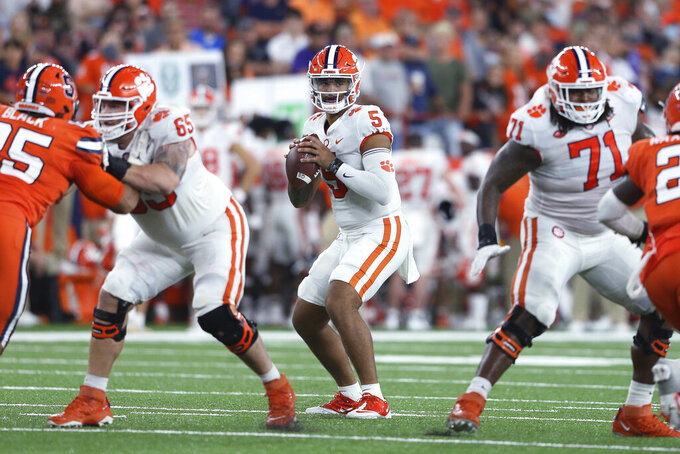 Clemson quarterback D.J. Uiagalelei (5) looks for a receiver during the fourth quarter of the team's NCAA football game against Syracuse in Syracuse, N.Y., Friday, Oct. 15, 2021. (AP Photo/Joshua Bessex)