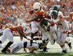 Texas wide receiver Lil'Jordan Humphrey (84) runs for a 3-yard touchdown against Baylor during the first half of an NCAA college football game, Saturday, Oct. 13, 2018, in Austin, Texas. (AP Photo/Eric Gay)