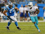 Miami Dolphins' Xavien Howard (25) returns an interception past Carolina Panthers' Greg Van Roten (73) in the first half of a preseason NFL football game in Charlotte, N.C., Friday, Aug. 17, 2018. (AP Photo/Nell Redmond)