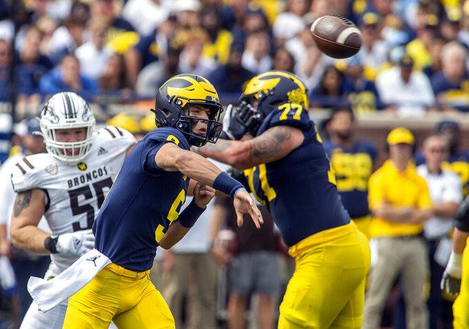 Michigan quarterback J.J. McCarthy (9) throws a pass in the third quarter of an NCAA college football game against Western Michigan in Ann Arbor, Mich., Saturday, Sept. 4, 2021. Michigan won 47-14. (AP Photo/Tony Ding)