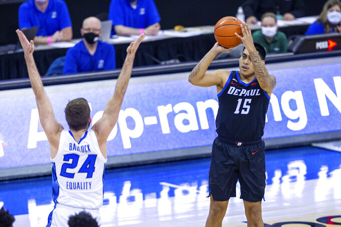 DePaul guard Oscar Lopez Jr. (15) makes a three point shot over Creighton guard Mitch Ballock (24) in the first half during an NCAA college basketball game Wednesday, Feb. 24, 2021, in Omaha, Neb. (AP Photo/John Peterson)
