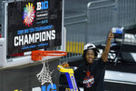 Illinois's Ayo Dosunmu celebrates as he cuts the net after Illinois defeated Ohio State in overtime of an NCAA college basketball championship game at the Big Ten Conference tournament, Sunday, March 14, 2021, in Indianapolis. (AP Photo/Darron Cummings)