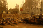 A sign still stands at a McDonald's restaurant burned in the Camp Fire, Monday, Nov. 12, 2018, in the northern California town of Paradise. (AP Photo/John Locher)