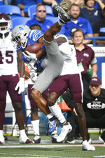 Memphis wide receiver Calvin Austin III (4) is brought down by Mississippi State cornerback Emmanuel Forbes after a reception during the first half of an NCAA college football game on Saturday, Sept. 18, 2021, in Memphis, Tenn. (AP Photo/John Amis)