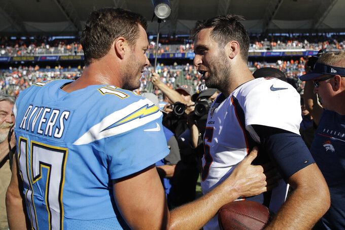 Los Angeles Chargers quarterback Philip Rivers greets Denver Broncos quarterback Joe Flacco after an NFL football game Sunday, Oct. 6, 2019, in Carson, Calif. (AP Photo/Marcio Jose Sanchez)