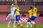 Brazil's players celebrate after defeating Mexico in a penalty shootout in a men's soccer semifinal match at the 2020 Summer Olympics, Tuesday, Aug. 3, 2021, in Kashima, Japan. (AP Photo/Fernando Vergara)