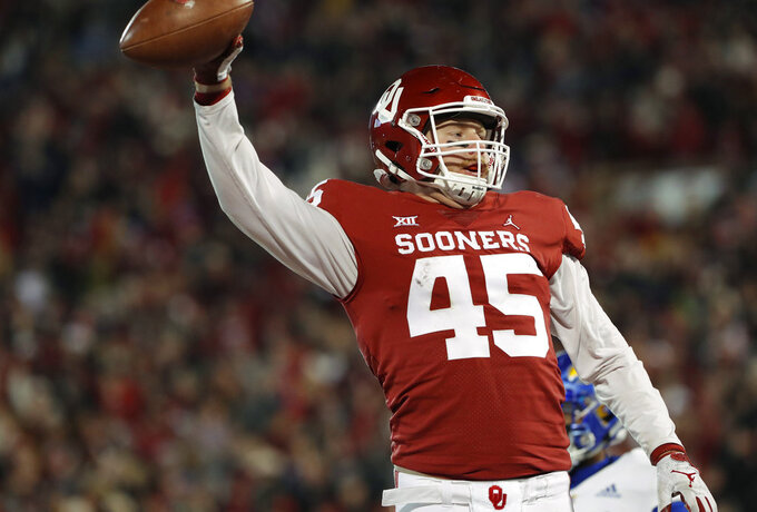 Oklahoma fullback Carson Meier (45) celebrates after a touchdown against Kansas during the first half of an NCAA college football game in Norman, Okla., Saturday, Nov. 17, 2018. (AP Photo/Alonzo Adams)