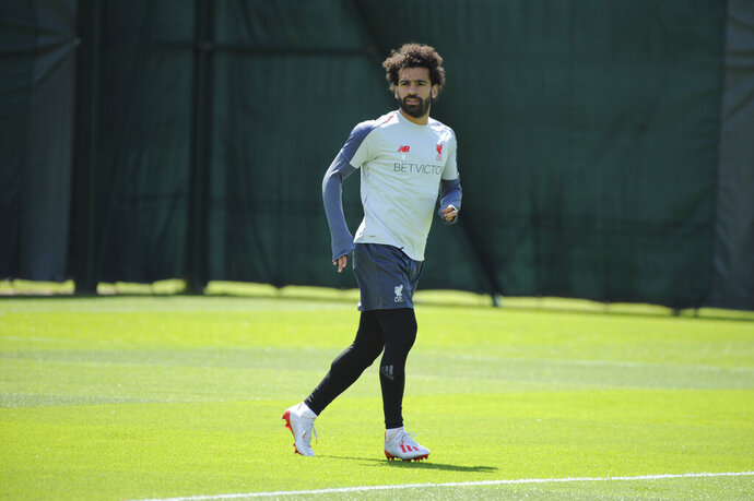 Liverpool's Mohamed Salah takes part in a training session at the Liverpool soccer team media open day, in Liverpool, England, Tuesday, May 28, 2019, ahead of their Champions League Final soccer match against Tottenham on Saturday in Madrid. (AP Photo/Rui Vieira)