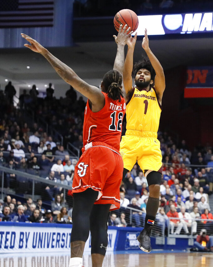 Arizona State's Remy Martin (1) shoots over St. John's Bryan Trimble Jr. (12) during the first half of a First Four game of the NCAA men's college basketball tournament Wednesday, March 20, 2019, in Dayton, Ohio. (AP Photo/John Minchillo)