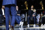 Former San Antonio Spurs guard Tony Parker, right, with former teammates Tim Duncan, left, and Manu Ginobili, center, listen to coach Gregg Popovich speak during Parker's retirement ceremony after the team's NBA basketball game against the Memphis Grizzlies in San Antonio, Monday, Nov. 11, 2019. (AP Photo/Eric Gay)