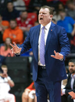 Illinois coach Brad Underwood calls out from the bench during the first half of the team's NCAA college basketball game against Wisconsin in Champaign, Ill., Wednesday, Jan. 23, 2019. (AP Photo/Stephen Haas)