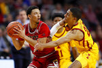 Northern Illinois guard Trendon Hankerson, left, looks to pass around Iowa State guard Tyrese Haliburton, right, during the first half of an NCAA college basketball game, Tuesday, Nov. 12, 2019, in Ames, Iowa. (AP Photo/Charlie Neibergall)