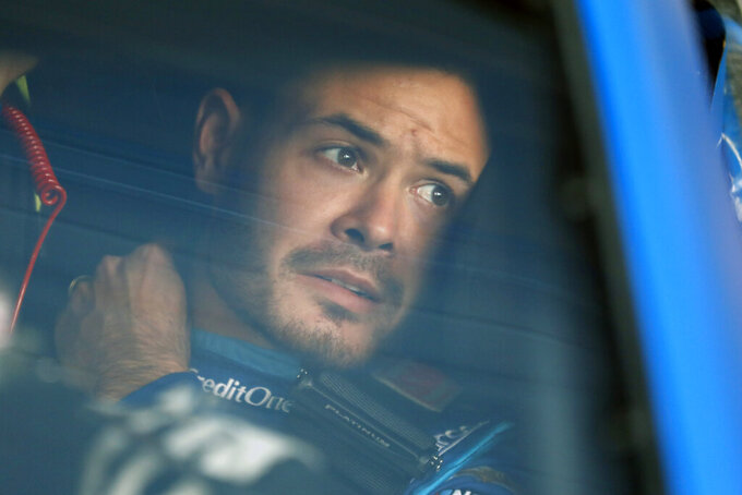 Kyle Larson sits in his car before the final practice for a NASCAR Cup Series auto race at Kansas Speedway in Kansas City, Kan., Friday, Oct. 18, 2019. (AP Photo/Colin E. Braley)