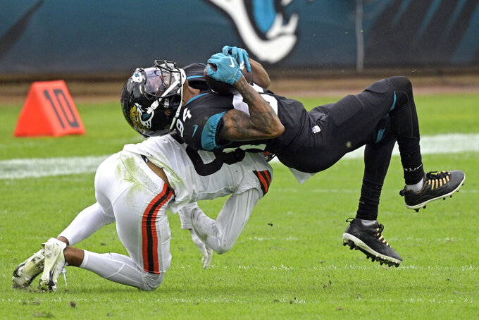 Jacksonville Jaguars wide receiver Keelan Cole Sr. (84) is stopped by Cleveland Browns cornerback Kevin Johnson, left, after a reception during the first half of an NFL football game, Sunday, Nov. 29, 2020, in Jacksonville, Fla. (AP Photo/Phelan M. Ebenhack)