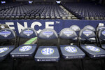 Am empty team bench area is shown at Bridgestone Arena in Nashville, Tenn., after the NCAA college basketball games at the Southeastern Conference men's tournament were cancelled, in this Thursday, March 12, 2020, file photo. The Southeastern Conference men's tournament played two games _ before fans no less _ a year ago.  Then the SEC shut it all down. (AP Photo/Mark Humphrey, File)