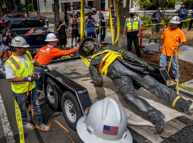 Workers remove a statue of John Sutter, a Swiss settler who built the first European settlement on the site of the city of Sacramento, outside Sutter hospital in midtown on Monday, June 15, 2020. Some historical accounts describe Sutter as using Native Americans as slaves and raping Native American girls as young as age 12. (Daniel Kim/The Sacramento Bee via AP)