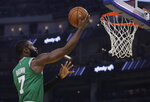 Boston Celtics' Jaylen Brown lays up a shot against the Golden State Warriors during the first half of an NBA basketball game Friday, Nov. 15, 2019, in San Francisco. (AP Photo/Ben Margot)