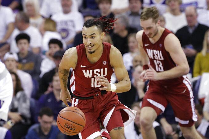 Washington State's Isaac Bonton drives upcourt during the first half of the team's NCAA college basketball game against Washington on Friday, Feb. 28, 2020, in Seattle. (AP Photo/Elaine Thompson)