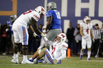 SMU quarterback Shane Buechele (7) gets help getting up from offensive lineman Cobe Bryant (57) during the second half of the team's NCAA college football game against Memphis on Saturday, Nov. 2, 2019, in Memphis, Tenn. Memphis won 54-48. (AP Photo/Mark Humphrey)