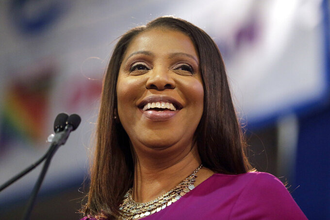 FILE - In this Jan. 6, 2019 file photo, Attorney General of New York, Letitia James, smiles during an inauguration ceremony in New York. James has opened a civil investigation into President Donald Trump's business dealings, taking action after his former lawyer told Congress he exaggerated his wealth to obtain loans. A person familiar with the inquiry said James issued subpoenas Monday, March 11, to Deutsche Bank and Investors Bank seeking records related to four Trump real estate projects and his failed 2014 bid to buy the NFL's Buffalo Bills.  (AP Photo/Seth Wenig, File)