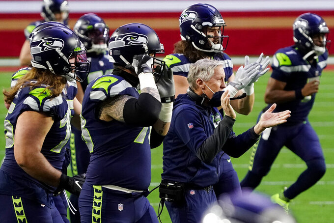 Seattle Seahawks head coach Pete Carroll cheers after a touchdown against the San Francisco 49ers during the second half of an NFL football game, Sunday, Jan. 3, 2021, in Glendale, Ariz. (AP Photo/Rick Scuteri)