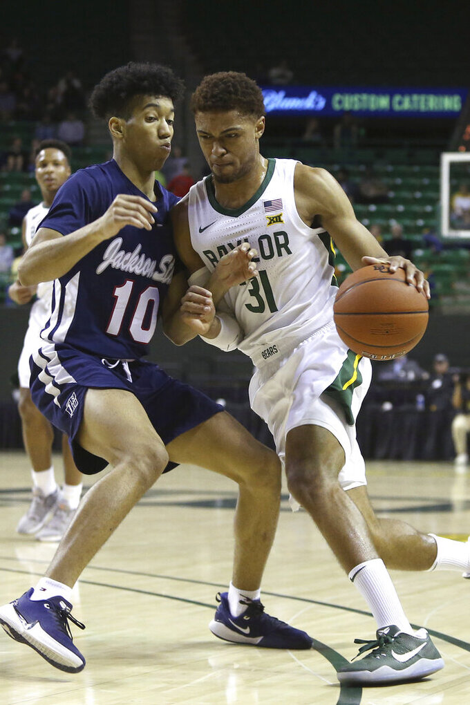Baylor guard MaCio Teague (31) drives against Jackson State guard Cainan McClelland (10) in the first half of an NCAA college basketball game, Monday, Dec. 30, 2019, in Waco, Texas. (AP Photo/Jerry Larson)