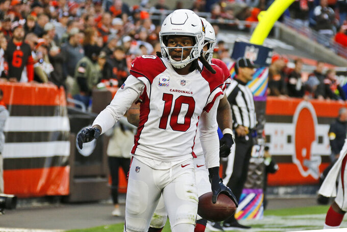 Arizona Cardinals wide receiver DeAndre Hopkins (10) celebrates after scoring a 9-yard touchdown during the second half of an NFL football game against the Cleveland Browns, Sunday, Oct. 17, 2021, in Cleveland. (AP Photo/Ron Schwane)