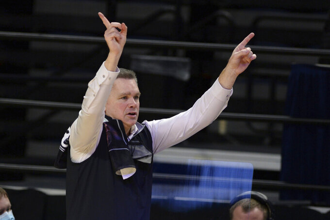 Ohio State coach Chris Holtmann gives instructions to the team late in the second half against Penn State in an NCAA college basketball game Thursday, Feb. 18, 2021, in State College, Pa. (AP Photo/Gary M. Baranec)