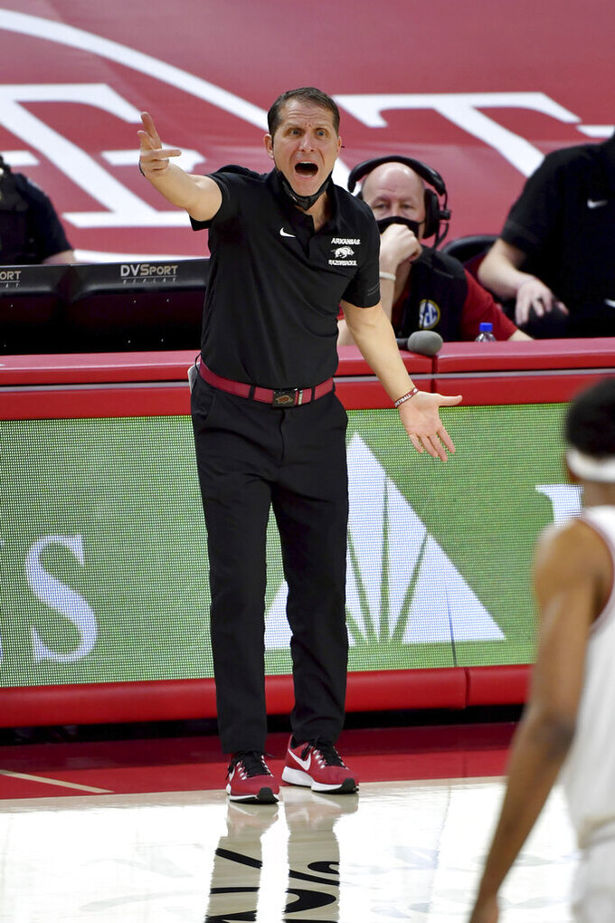 Arkansas coach Eric Musselman reacts on the sideline during the second half of an NCAA college basketball game against LSU in Fayetteville, Ark. Saturday, Feb. 27, 2021. (AP Photo/Michael Woods)
