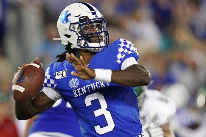 FILE - In this Sept. 7, 2019, file photo, Kentucky quarterback Terry Wilson (3) throws the ball during the first half of an NCAA college football game againstr Eastern Michigan, in Lexington, Ky. Terry Wilson has waited for football's return even longer than most of his Southeastern Conference brethren. No. 23 Kentucky's quarterback will take the field again Saturday, Sept. 26, 2020, at No. 8 Auburn, returning from a knee injury that cost him almost all of last season. His Tigers' counterpart in the SEC's opening weekend is Bo Nix, coming off a strong freshman season.(AP Photo/Bryan Woolston, File)