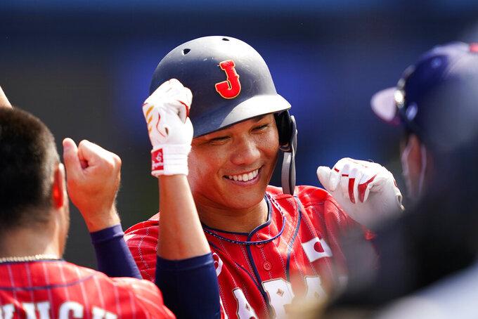 Japan's Hayato Sakamoto celebrates after hitting a home run during a baseball game against Mexico at Yokohama Baseball Stadium during the 2020 Summer Olympics, Saturday, July 31, 2021, in Yokohama, Japan. (AP Photo/Matt Slocum)