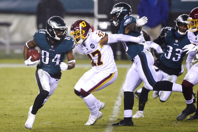 Philadelphia Eagles' Greg Ward (84) runs past Washington Football Team's Khaleke Hudson (47) during the second half of an NFL football game against the Washington Football Team, Sunday, Jan. 3, 2021, in Philadelphia. (AP Photo/Derik Hamilton)