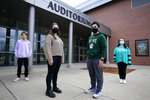 While wearing protective masks due to the COVID-19 outbreak, Lucy Vitali, who portrays Juliet, second from left, poses with Alex Mansour, who portrays Romeo, second from right, outside an auditorium after working on their virtual performance of Shakespeare's
