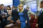 In this photo taken on Tuesday, July 23, 2019, opposition candidate and lawyer at the Foundation for Fighting Corruption Lyubov Sobol stands leaning on a chair after a meeting with Ella Pamfilova, head of Russian Central Election Commission during after a meeting at the Russian Central Election commission in Moscow, Russia.  Sobol, who was on a hunger strike for a month protesting an official refusal to register her to run for the Moscow city legislature, argues that the Kremlin won't be able to stop the rising wave of public discontent as more and more Russians are losing trust in authorities. (AP Photo/Alexander Zemlianichenko)