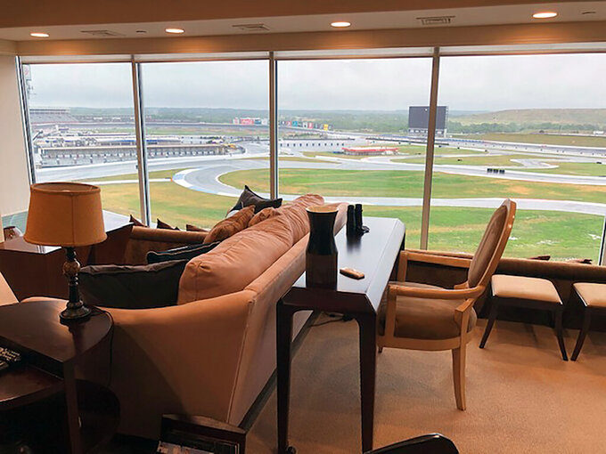 View from a condominium at Charlotte Motor Speedway in Concord, N.C. Wednesday, May 20, 2020. Fans aren't allowed to watch NASCAR races live yet due to the coronavirus restrictions -- unless you happen to own a condominium at Charlotte Motor Speedway. The condos at the track create a unique loophole in the rules where owners who live there -- and four of their friends or family -- will be able to watch the Coca-Cola 600 on Sunday from the comfort of their trackside condos. (AP Photo/Steve Reed)
