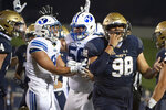 Navy guard Mike Flowers (98) reacts as BYU running back Lopini Katoa (4) celebrates after scoring a touchdown during the first half of an NCAA college football game, Monday, Sept. 7, 2020, in Annapolis, Md. (AP Photo/Tommy Gilligan)