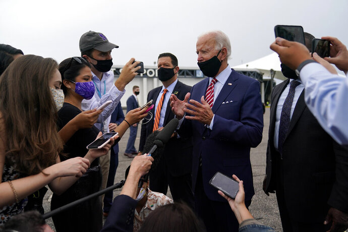 Democratic presidential candidate former Vice President Joe Biden speaks with reporters before boarding a plane at Tampa International Airport in Tampa, Fla., Tuesday, Sept. 15, 2020. Biden is en route to Kissimmee, Fla., for a campaign event. (AP Photo/Patrick Semansky)