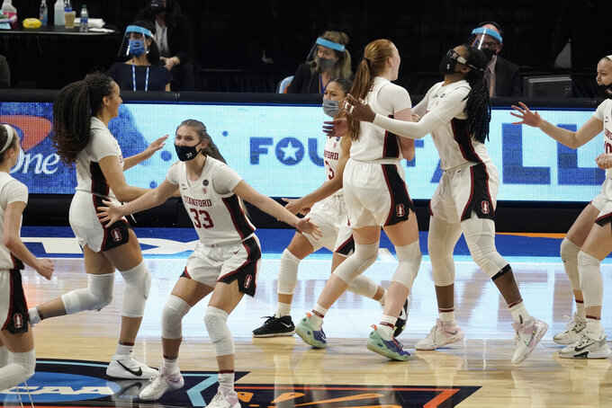 Stanford players celebrate at the end of a women's Final Four NCAA college basketball tournament semifinal game against South Carolina Friday, April 2, 2021, at the Alamodome in San Antonio. Stanford won 66-65. (AP Photo/Morry Gash)