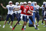New England Patriots quarterbacks Brian Hoyer (2) and Jarrett Stidham (4) warm up along with and tight end Andrew Beck (86) at NFL football practice, Monday, Aug. 19, 2019, in Foxborough, Mass. (AP Photo/Elise Amendola)