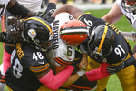 Cleveland Browns quarterback Baker Mayfield (6) is sacked by Pittsburgh Steelers defensive end Stephon Tuitt (91) and outside linebacker Bud Dupree (48) during the first half of an NFL football game, Sunday, Oct. 18, 2020, in Pittsburgh. (AP Photo/Don Wright)