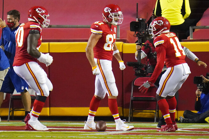 Kansas City Chiefs tight end Travis Kelce (87) celebrates with wide receiver Sammy Watkins (14) after Kelce caught a touchdown pass against the Houston Texans in the first half of an NFL football game Thursday, Sept. 10, 2020, in Kansas City, Mo. (AP Photo/Jeff Roberson)