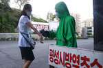 A health official conducts anti-epidemic work at the entrance of Phyongsong city in south Phyongan Province, North Korea Wednesday, Sept. 1, 2021. (AP Photo/Jon Chol Jin)